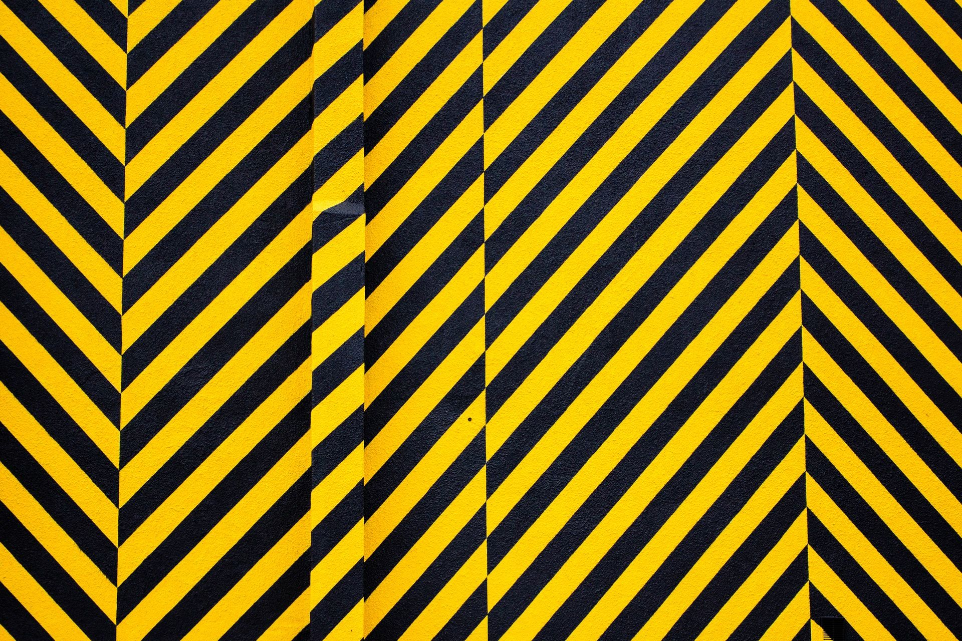 A wall panted with diagonal black and yellow stripes