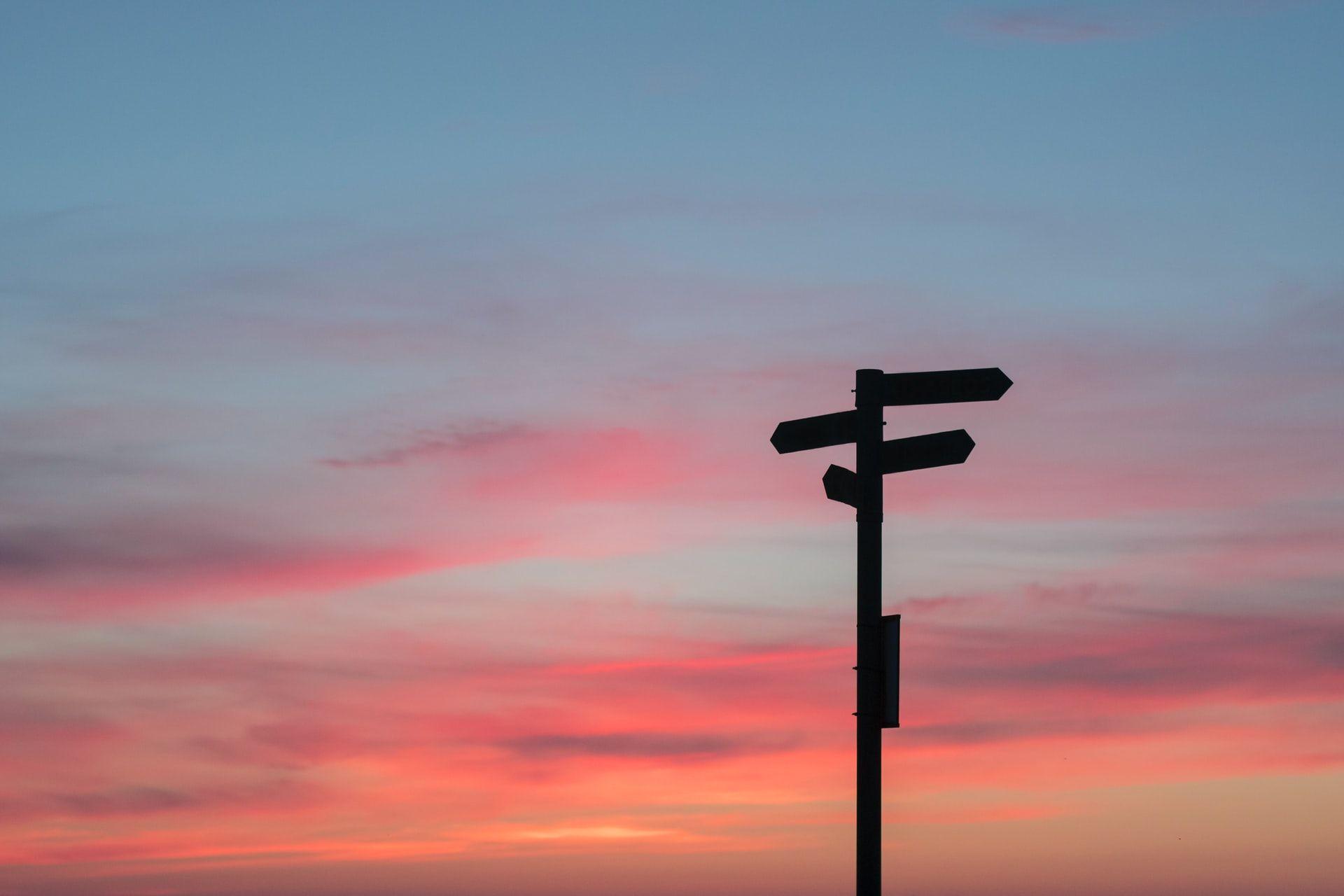Signpost at dusk