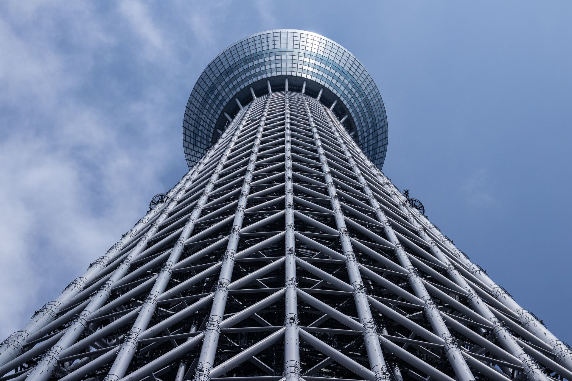 Skytree Tower in Tokyo. Looking up the tower from its base, structural elements visible