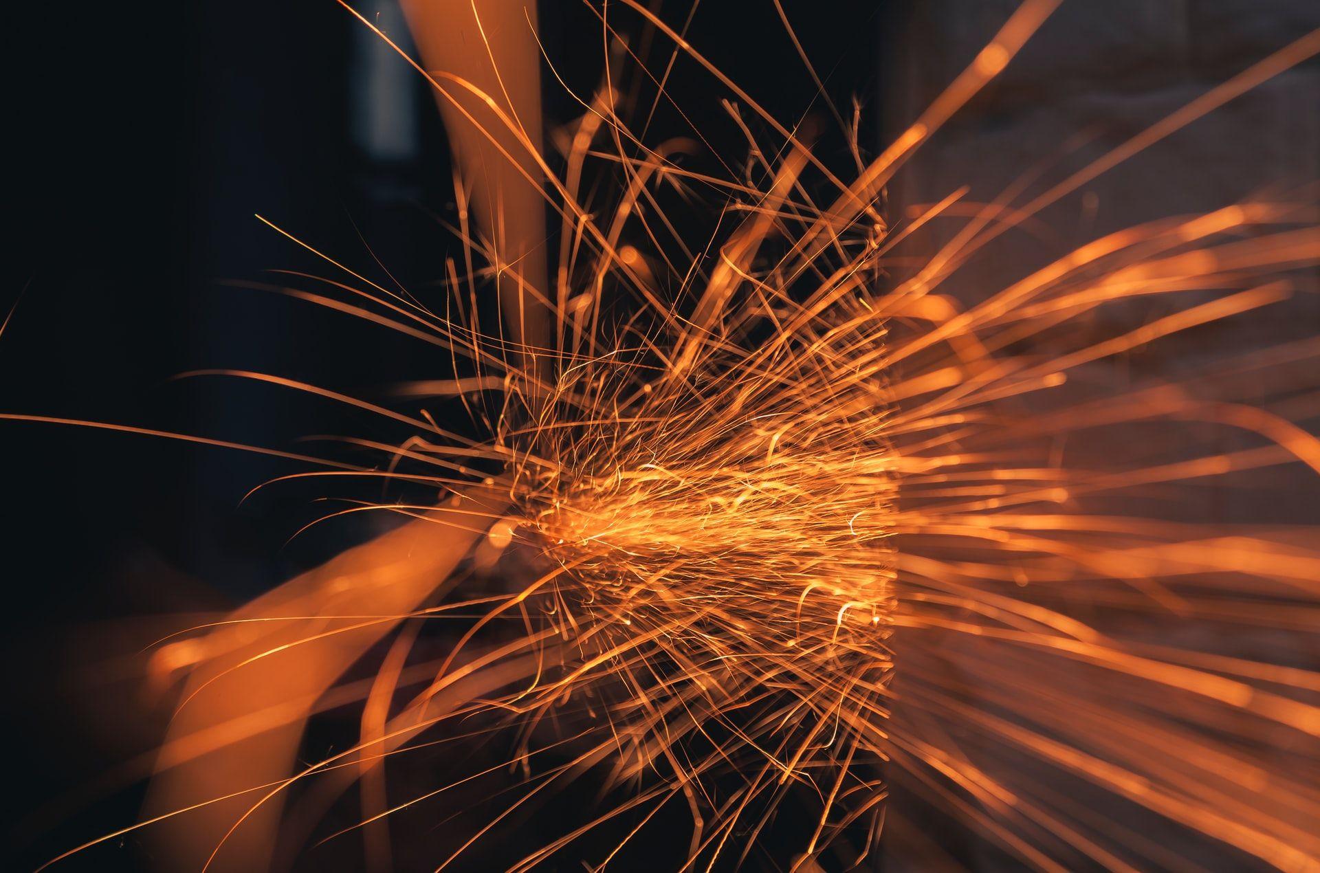 Grinder creating sparks via friction
