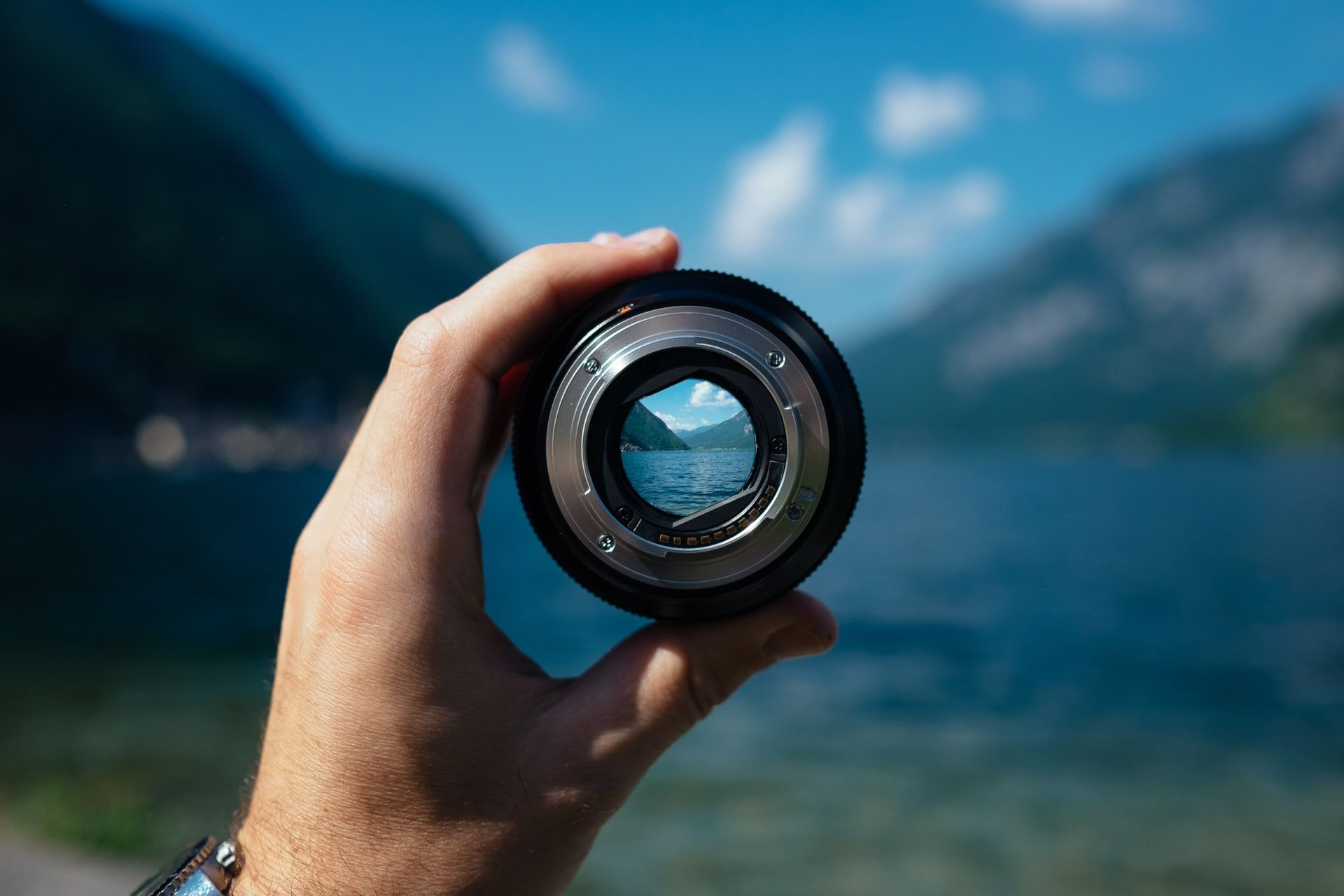 Looking at a view of a lake through a camera lens